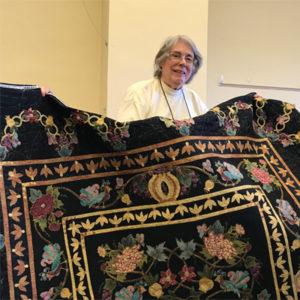 Holding a finished quilt