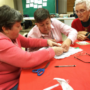 Quilters designing a pattern