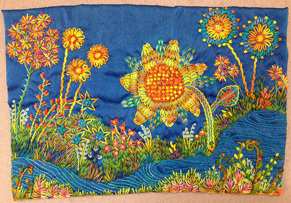 Detail of an art quilt of colorful flowers