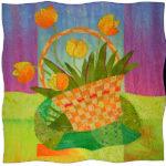 An art quilt of a basket of flowers