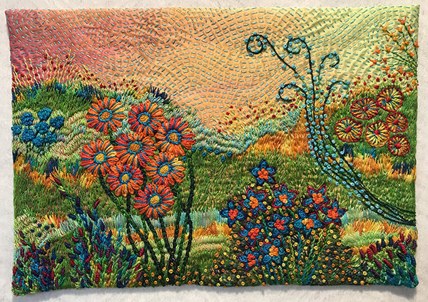 An embroidered art quilt of a garden