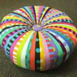 A brightly-colored fabric tuffet