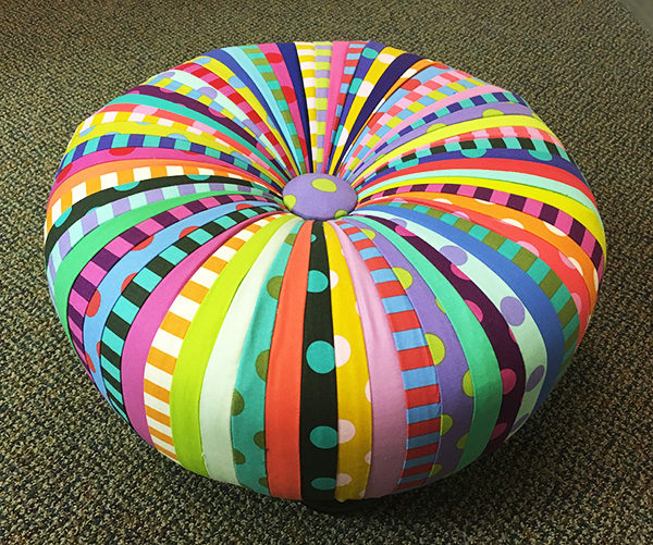 A colorful fabric tuffet