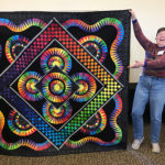 Colorful quilt made at the Quilt-In