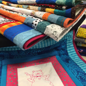 A range of colorful quilts made for charity