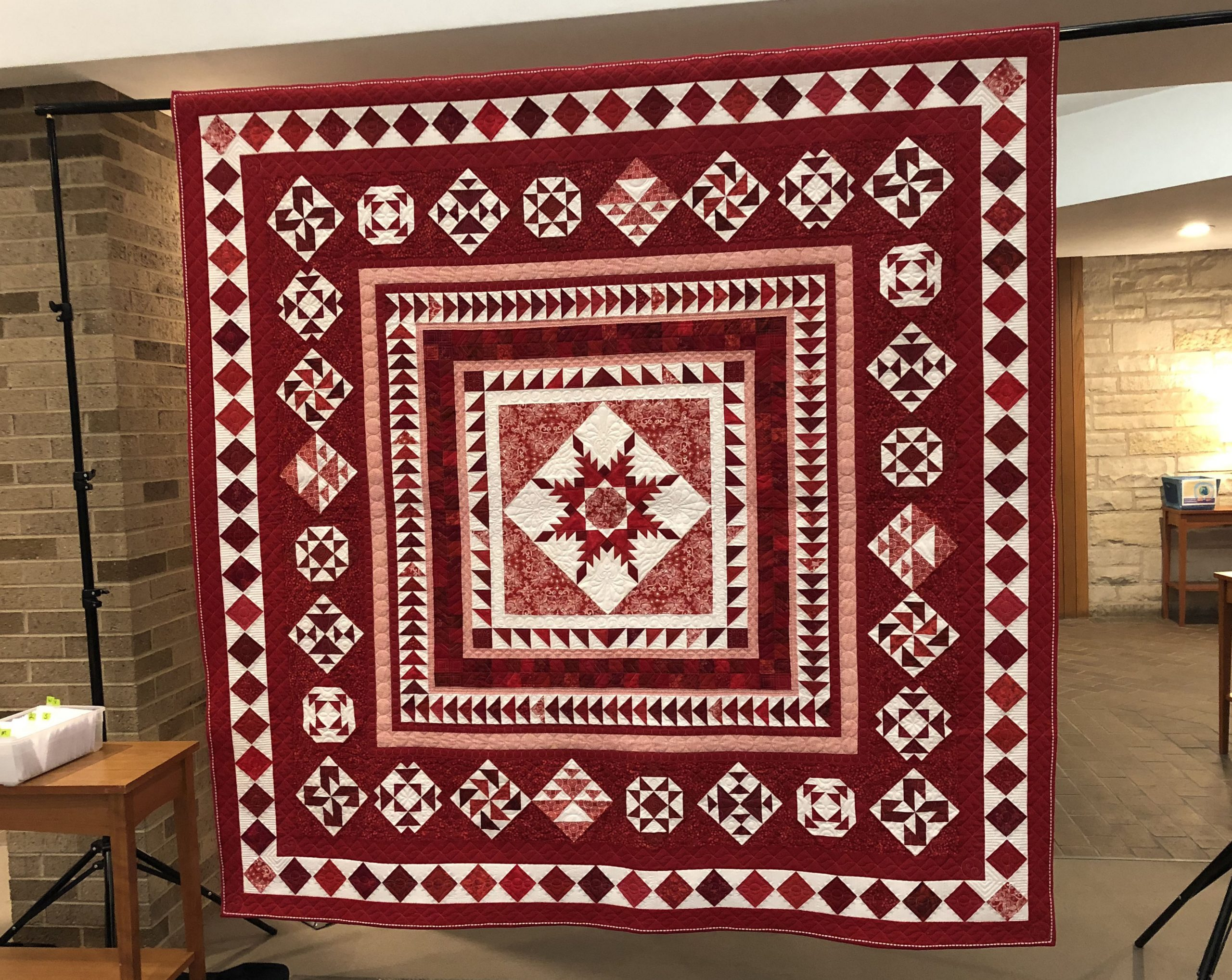 """The 2020-21 IQI Raffle Quilt (""""Ruby Jubilee"""")"""