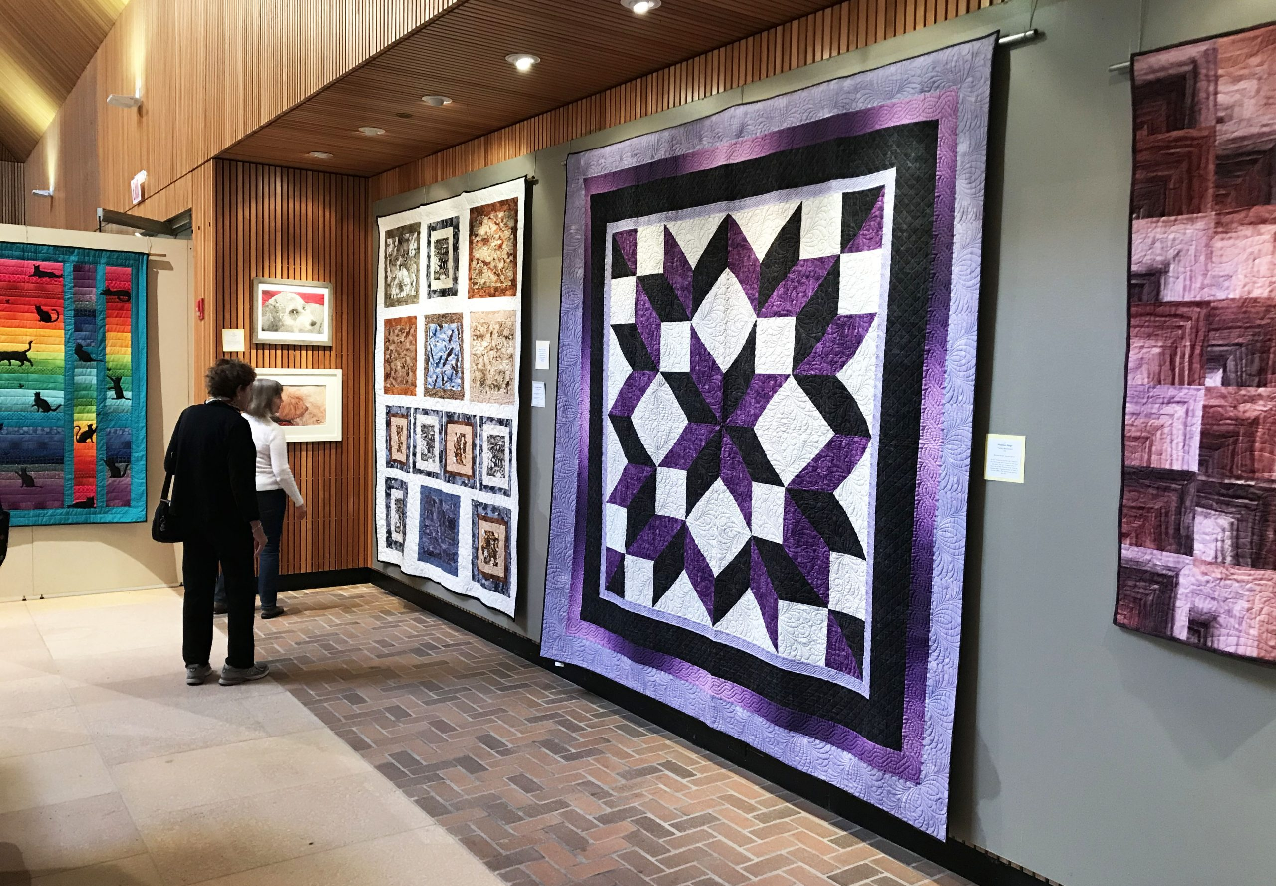 A bold purple quilt in the Fine Art of Fiber gallery