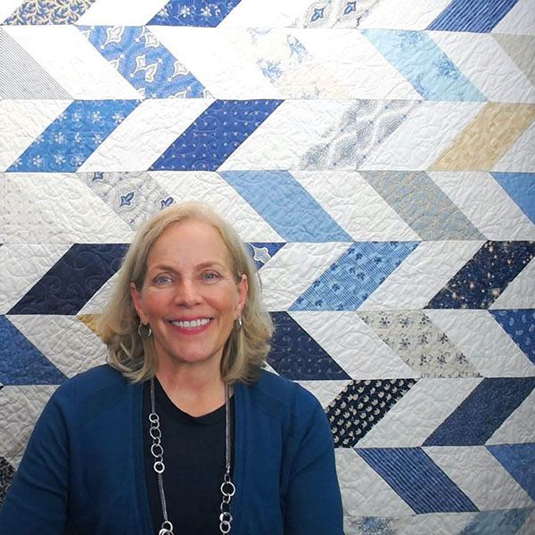 Portrait of Rose Parr beside a quilt