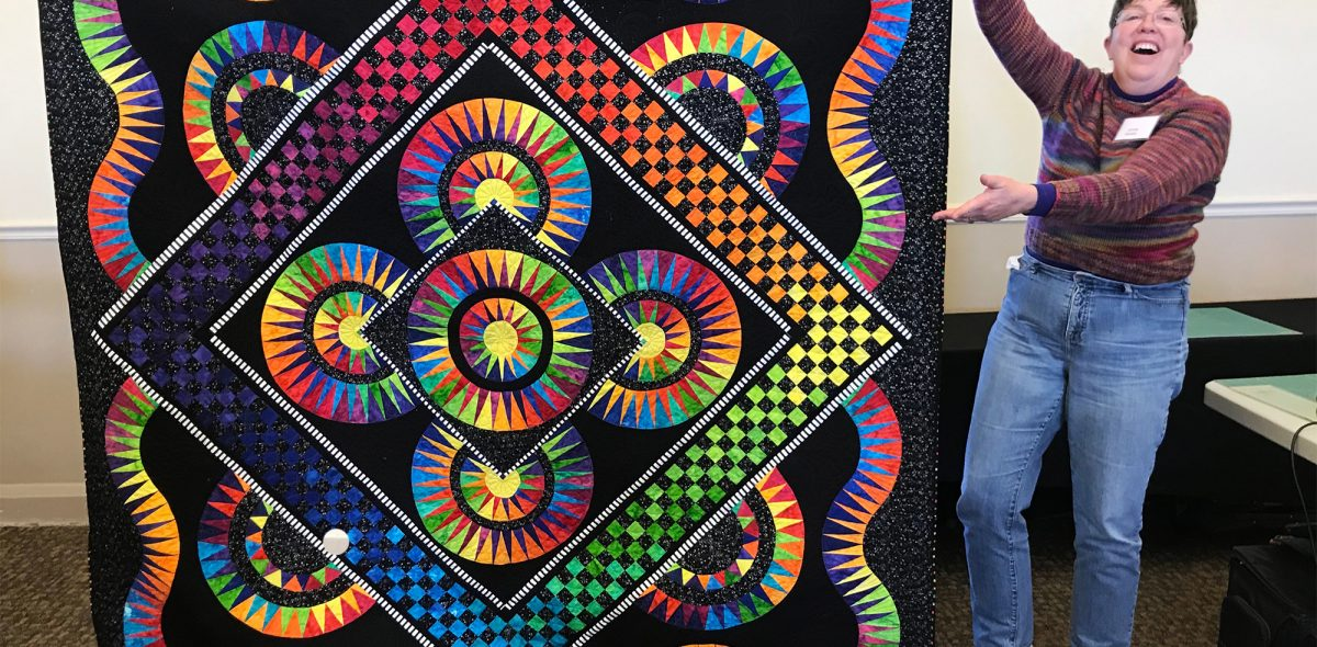 A colorful quilt made at the Quilt-in