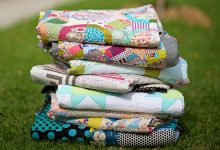 A stack of quilts by Jen Kingwell